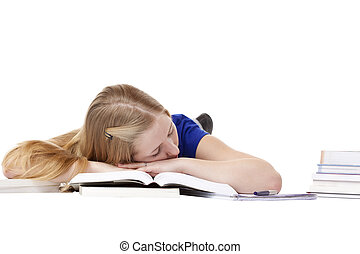 Young attractive female student sleeping at books on floor
