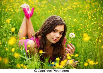 woman blow on dandelion - summer woman blow on dandelion