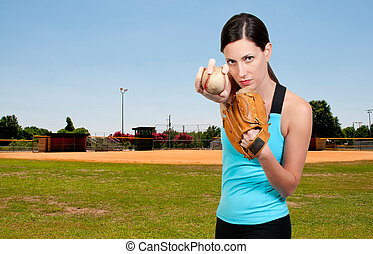 Woman Baseball Player - A beautiful woman throwing a...