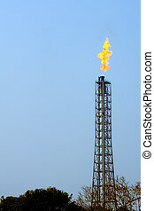 A flare stack burning off excess gas at the Mathura Refinery...