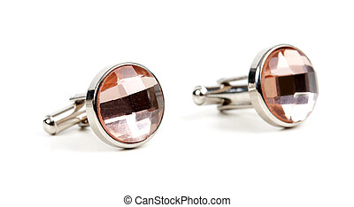 pair of platinum cufflinks with a pink stone isolated on...