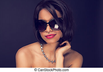 sexy brunette elegant woman wearing sunglasses and necklace