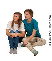 boy and girl sitting on the floor