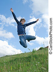 happy men - Young happy men jumping against summer landscape