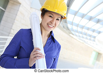Asian Architect on Construction Site - A young and pretty...