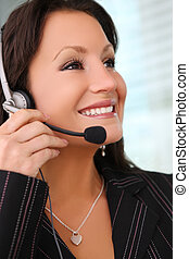 Business Woman With Earphone - A pretty business woman with...