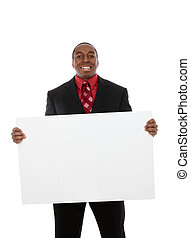 Handsome Business Man with Sign - A handsome african...