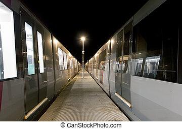 Subway depot - Train cars at a subway depot at night