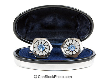 pair of platinum stud with topaz in an open casket isolated...
