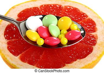 Vitamins on a slice of citrus - Vitamins on a slice of...
