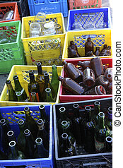 recycle glass bottles - different glass bottles at a...