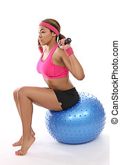 Pretty Woman Exercising - A pretty african american woman...