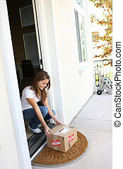 Pretty Woman Getting Delivery - A pretty woman at home...