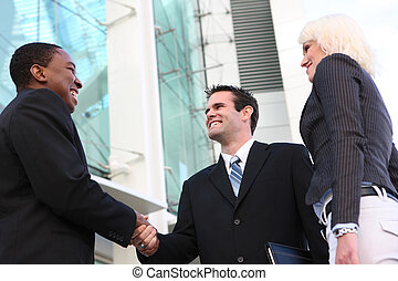 Diverse Business Team Shaking Hands - A diverse ethnic...