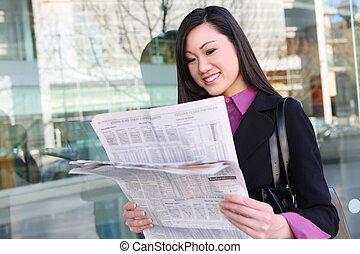 Asian Business Woman Reading Newspaper
