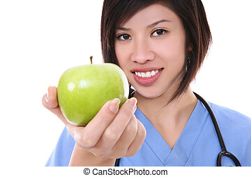 Pretty Asian Nurse with Apple - A pretty asian nurse holding...
