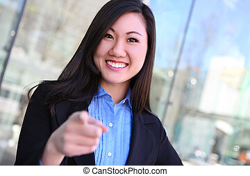 Asian Business Woman Pointing - A pretty young asian...