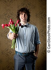 For you - An image of handsome man with red tulips