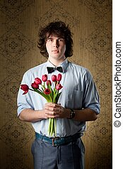 With love - An image of a handsome man with red tulips