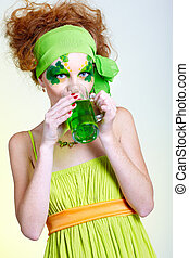girl with green beer - portrait of beautiful red-haired...