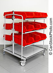 Supply red cart - Supply trolley with plastic red boxes for...