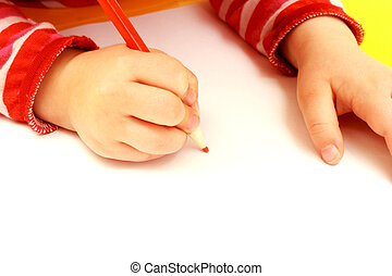 hand of child drawing on a paper