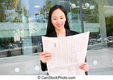 Asian Business Woman Reading Newspaper - A pretty asian...