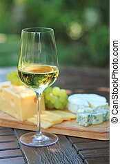Various sorts of cheese, grapes and white wine - Various...
