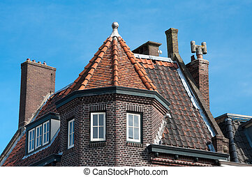 roof top - tiled roof top with several chimneys