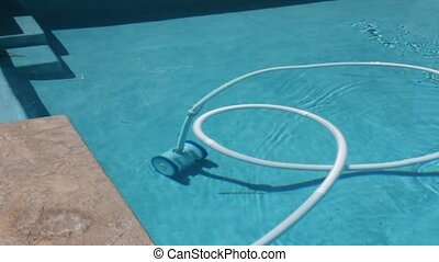 Swimming Pool Cleaning Machine - A video of a pool cleaning...