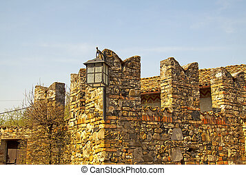 Wall - Old medieval wall with bricks and battlements