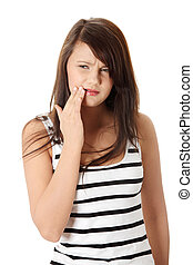 Beautiful young woman is having toothache