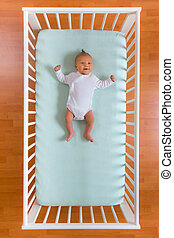 top view of baby in cot - the top view of baby in cot