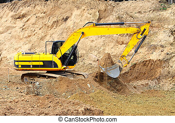 dredge - Old dredge digging the earth, photographed against...