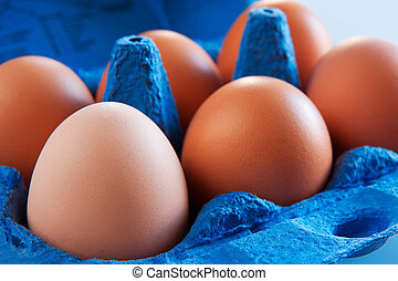 Eggs in carton - Brown Eggs In blue carton