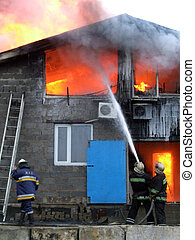 firefighters extinguish a fire - Three firefighters...