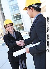 Business Construction Man and Woman - An attractive business...