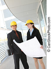 Business Team at Office Construction Site - An attractive...