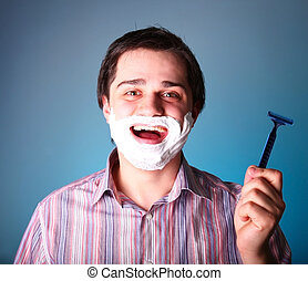 Man shaving isolated on blue background