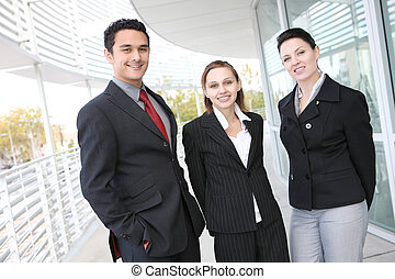 Young Diverse Business Team - A young and diverse man and...