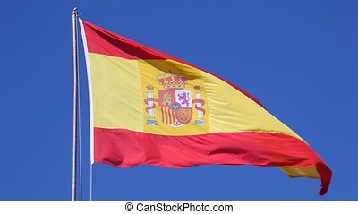 Flag of Spain against a blue sky