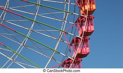 Ferris wheel - Detail shot of a ferris wheel against blue...