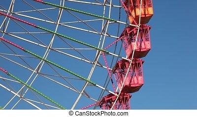 Ferris wheel - Detail shot of a ferris wheel against blue...