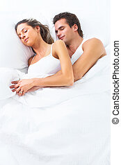 Sleeping couple. - Young happy couple sleeping in bed. Love.