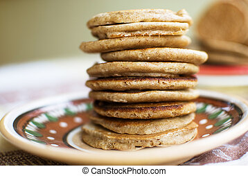 sweet pancakes - stack of sweet oat pancakes on ceramic...