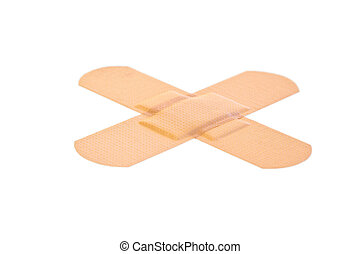 Cross-shaped band-aid on a white background