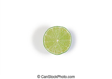 Half green lemon on a white background