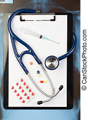 Notepad, blister strip and medicine - Note pad and blister...
