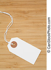 White tag isolated on a desk