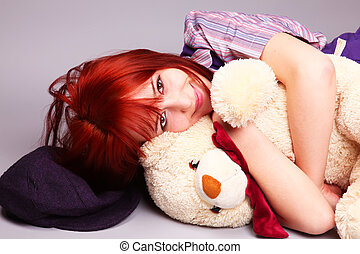 Beautiful girl sleeping with teddy bear at St. Valentine's Day